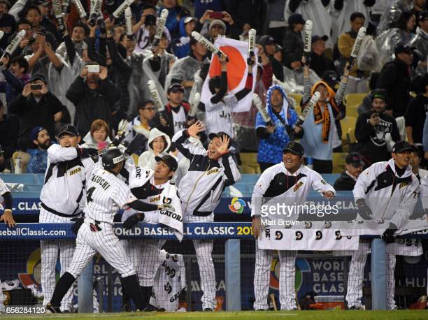 Ryosuke Kikuchi of of Team Japan celebrates with teammates after hitting a solo home run in the sixth inning of Game 2 of the Championship Round of...