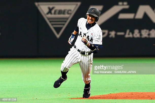 Ryosuke Kikuchi of Samurai Japan hit a triple in the bottom half of the seventh inning during the game five of Samurai Japan and MLB All Stars at...