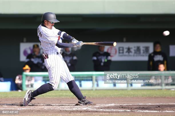 Ryosuke Kikuchi of Samurai Japan hits a single in the sixth inning during the SAMURAI JAPAN Friendly Opening Match between SAMURAI JAPAN and Fukuoka...