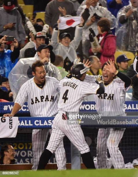 Ryosuke Kikuchi of team Japan celebrates his gametying home run with Shogo Akiyama in the sixth inning against team United States during Game 2 of...