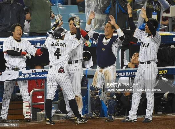Ryosuke Kikuchi of team Japan celebrates his gametying home run with teammates in the sixth inning against team United States during Game 2 of the...