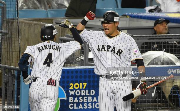 Ryosuke Kikuchi of team Japan celebrates his gametying home run with teammate Norichika Aoki in the sixth inning against team United States during...