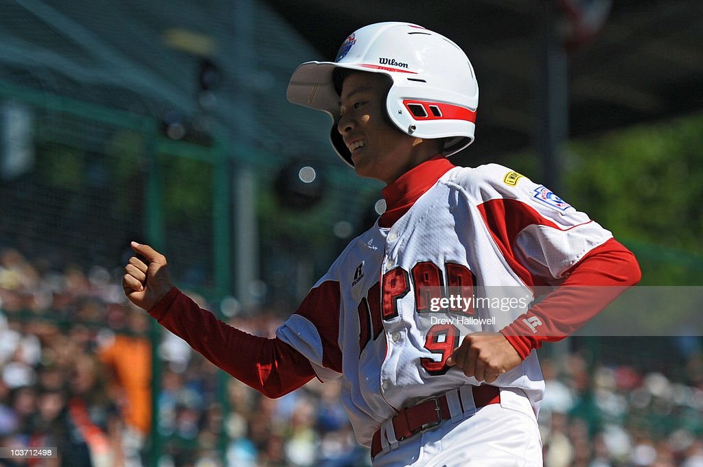 Ryosuke Sugawara #9 of the Japan Little League team celebrates after scoring the first run of the game against United States on August 29, 2010 in South Willamsport, Pennsylvania. Japan went on to win the Little League World Series Championship 4-1.