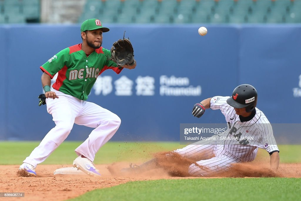 Ryosuke Tatsumi #23 of Japan steals second base under tag of Carlos Esqueda #12 of Mexico during the Baseball Group B match between Japan and Mexico during the Universiade Taipei at the Xinzhuang Baseball Stadium on August 22, 2017 in Taipei, Taiwan.