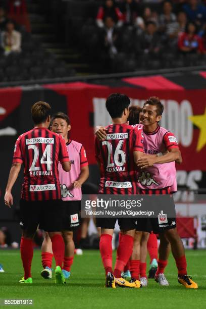 Ryota Hayasaka of Consadole Sapporo is congratulated by Junichi Inamoto after scoring the opening goal during the JLeague J1 match between Consadole...