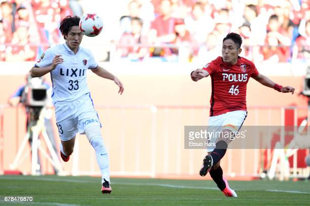 Ryota Kashiwagi of Urawa Red Diamonds and Mu Kanazaki of Kashima Antlers compete for te ball during the JLeague J1 match between Urawa Red Diamonds...
