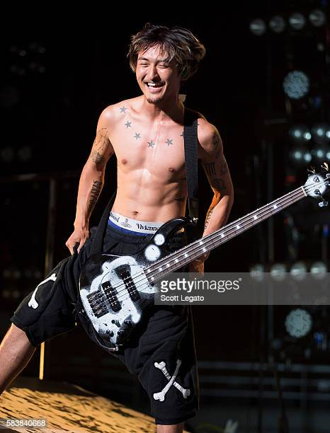 Ryota Kohama of One OK Rock performs at The Palace of Auburn Hills on July 27 2016 in Auburn Hills Michigan