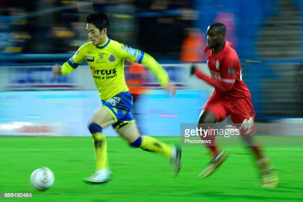 Ryota Morioka forward of Beveren is challenged by PaulJose Mpoku forward of Standard Liege during the Jupiler Pro League match between...
