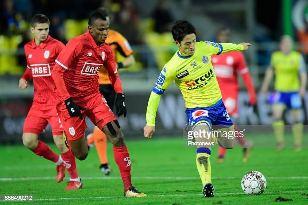 Ryota Morioka forward of Beveren is challenged by Uche Henry Agbo defender of Standard Liege during the Jupiler Pro League match between...