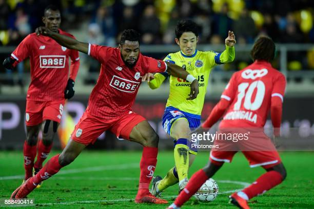 Ryota Morioka forward of Beveren is fighting for the ball with Christian Luyindama midfielder of Standard Liege during the Jupiler Pro League match...