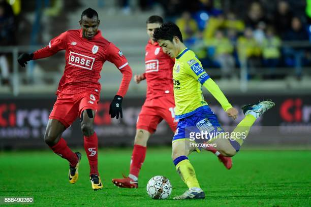 Ryota Morioka forward of Beveren shoots towards the goal in front of Uche Henry Agbo defender of Standard Liege during the Jupiler Pro League match...