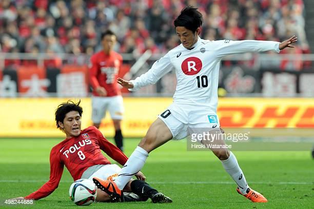 Ryota Morioka of Vissel Kobe and Yosuke Kashiwagi of Urawa Red Diamonds compete for the ball during the JLeague match between Urawa Red Diamonds and...