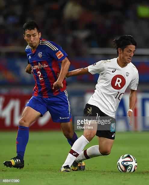 Ryota Morioka of Vissel Kobe and Yuhei Tokunaga of FC Tokyo compete for the ball during the JLeague match between FC Tokyo and Vissel Kobe at...