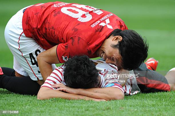 Ryota Moriwaki and Nobuhisa Yamada look on after Miss of Nobuhisa Yamada during the testimonial for Nobuhisa Yamada of Urawa Red Diamonds at Saitama...