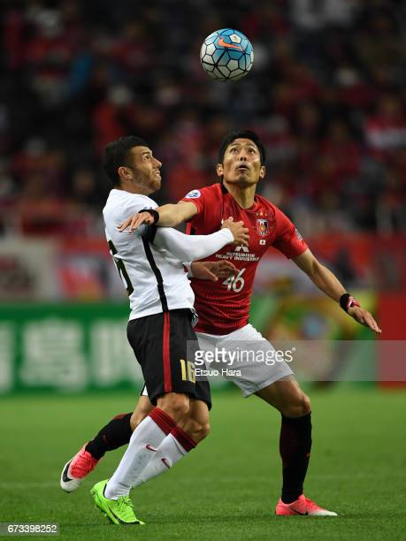 Ryota Moriwaki of Urawa Red Diamonds and Jaushua Sotirio of Western Sydney compete for the ball during the AFC Champions League Group F match between...