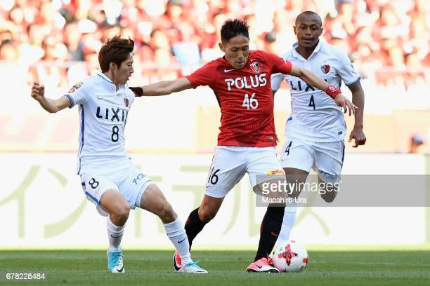 Ryota Moriwaki of Urawa Red Diamonds and Shoma Doi of Kashima Antlers compete for the ball during the JLeague J1 match between Urawa Red Diamonds and...