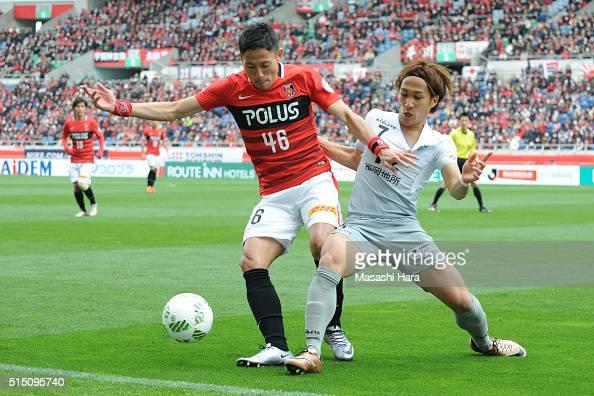 Ryota Moriwaki of Urawa Red Diamonds and Takeshi Kanamori of AVispa Fukuoka compete for the ball during the JLeague match between Urawa Red Diamonds...