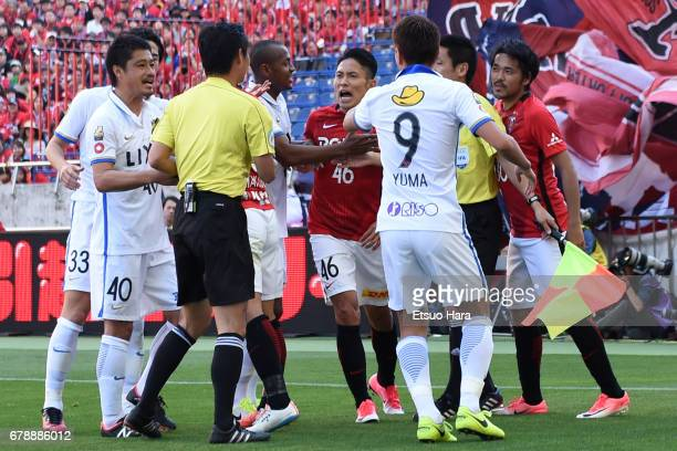 Ryota Moriwaki of Urawa Red Diamonds argues with Leo Silva of Kashima Antlers during the JLeague J1 match between Urawa Red Diamonds and Kashima...