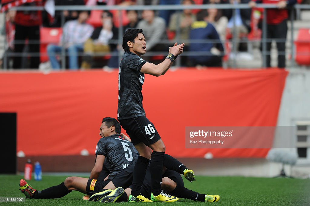 Ryota Moriwaki of Urawa Red Diamonds celebrates their last minute winning goal during the J. League match between Nagoya Grampus and Urawa Red Diamonds at the Toyota Stadium on April 12, 2014 in Toyota, Japan.