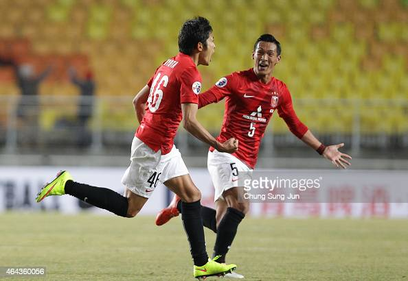 Ryota Moriwaki of Urawa Red Diamonds celebrates with Tomoaki Makino after scores a goal during the AFC Champions League Group G match between Suwon...