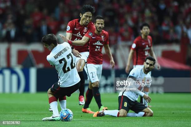 Ryota Moriwaki of Urawa Red Diamonds competes for the ball against Jonathan Aspropotamitis of Western Sydney Wanderers during the AFC Champions...