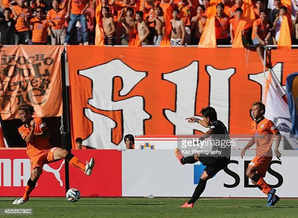 Ryota Moriwaki of Urawa Reds scores his team's first goal during the JLeague match between Shimizu SPulse and Urawa Red Diamonds at Ecopa Stadium on...