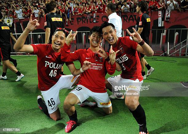 Ryota Moriwaki Yuki Muto and Tomoaki Makino of Urawa Reds celebrate their 52 win and undefeated first stage champion after the JLeague match between...