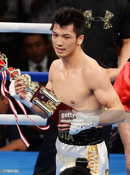 Ryota Murata of Japan celebrates after defeating Akio Shibata of Japan during his debut match as professional boxer against Akio Shibata at Ariake...