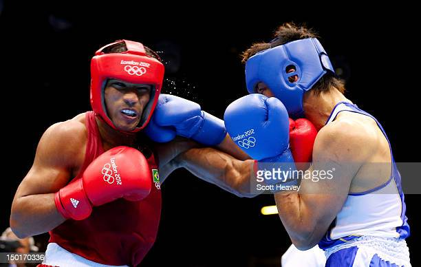 Ryota Murata of Japan exchanges punches with Esquiva Falcao Florentino of Brazil during the Men's Middle Boxing final bout on Day 15 of the London...