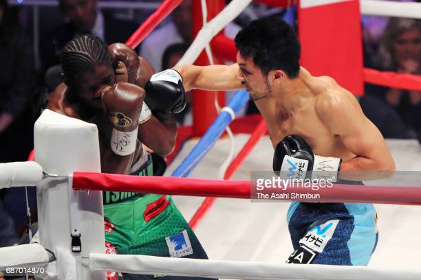 Ryota Murata of Japan knocks down Hassan N'Dam N'Jikam of France in the first round during the WBA World Middleweight title bout at Ariake Colosseum...