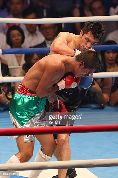 Ryota Murata of Japan punches Adrian Luna Flores of Mexico during the nontitle bout between Adrian Luna Flores of Mexico and Ryota Murata of Japan at...