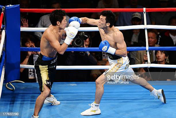 Ryota Murata of Japan punches Akio Shibata of Japan during his debut match as professional boxer against Akio Shibata at Ariake Colosseum on August...