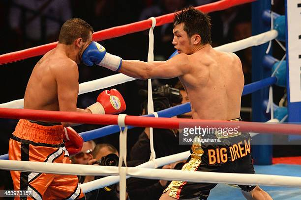 Ryota Murata of Japan punches Dave Peterson of United States during the 8 rounds Middleweight division bout at Ryogoku Kokugikan on December 6 2013...
