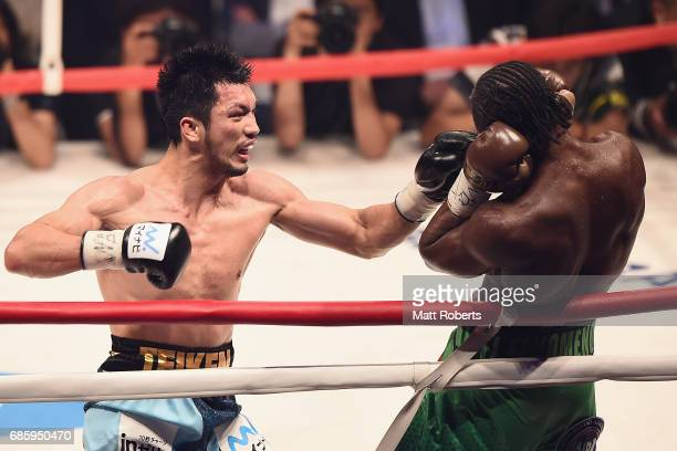 Ryota Murata of Japan punches Hassan N'Dam N'Jikam of France during the WBA World Middleweight title bout between Hassan N'Dam N'Jikam and Ryota...