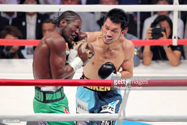 Ryota Murata of Japan punches Hassan N'Dam N'Jikam of France in the sixth round during the vacant WBA World Middleweight title bout at Ariake...