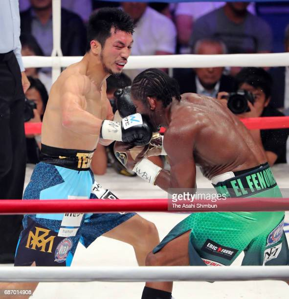 Ryota Murata of Japan punches Hassan N'Dam N'Jikam of France in the fourth round during the WBA World Middleweight title bout at Ariake Colosseum on...