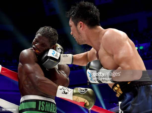 TOPSHOT Ryota Murata of Japan punches Hassan NDam of France during the World Boxing Association middleweight title bout in Tokyo on October 22 2017 /...
