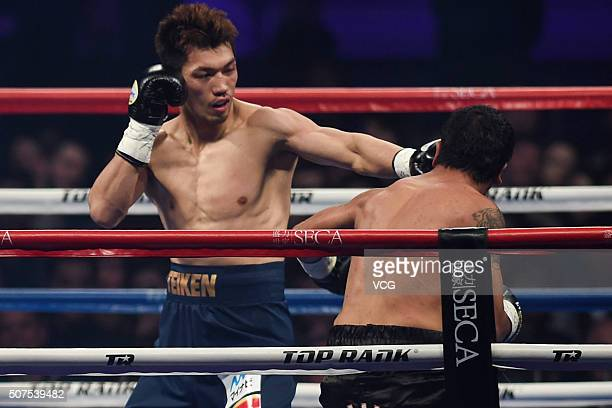 Ryota Murata of Japan throws a punch against Gaston Alejandro Vega of Argentina in the Boxing Middleweight Bout of 'The Return Of The King' Boxing...