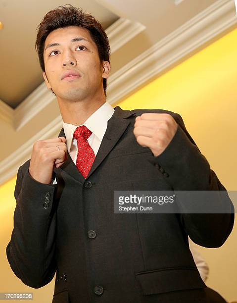 Ryota Murata poses with his fists up at a press conference announcing his signing with Top Rank Boxing as he starts his professional career at...