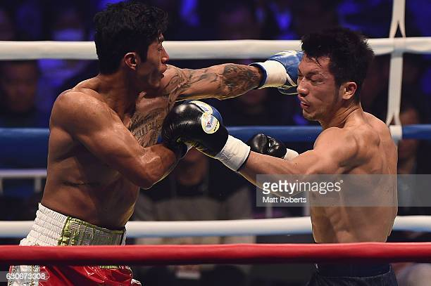 Ryota Murata punches Bruno Sandoval during the nontitle bout between Ryota Murata and Bruno Sandoval at the Ariake Colosseum on December 30 2016 in...