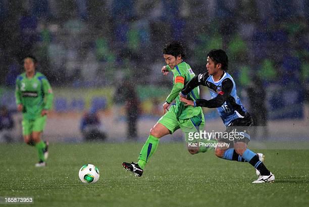 Ryota Nagaki of Shonan Bellmare and Ryota Oshima of Kawasaki Frontale compete for the ball during the JLeague match between Shonan Bellmare and...