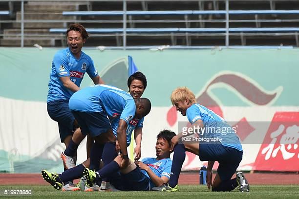 Ryota Nagata of Kamatamare Sanuki celebrates the opener with his team mates during the JLeague second division match between Kamatamare Sanuki and FC...