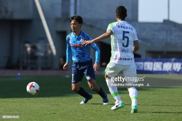Ryota Nagata of Kamatamare Sanuki takes on Hiroki Akino of Shonan Bellmare during the JLeague J2 match between Kamatamare Sanuki and Shonan Bellmare...