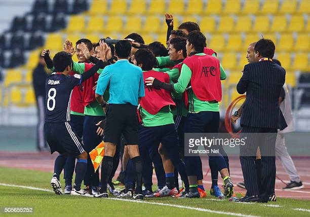 Ryota Ohshima of Japan 8 celebrates with the team bench as he scores their first goal during the AFC U23 Championship Group B match between Saudi...