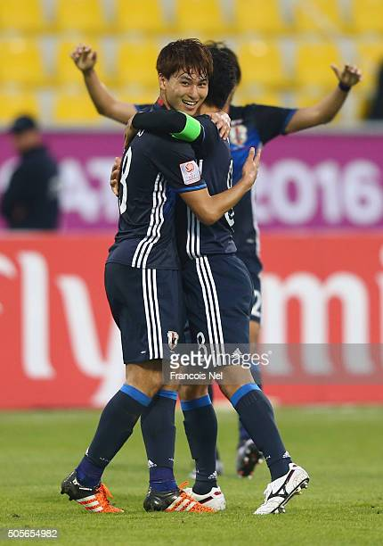 Ryota Ohshima of Japan celebrates with team mate Takumi Minamino as he scores their first goal during the AFC U23 Championship Group B match between...