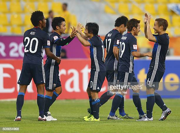 Ryota Ohshima of Japan celebrates with team mates as he scores their first goal during the AFC U23 Championship Group B match between Saudi Arabia...