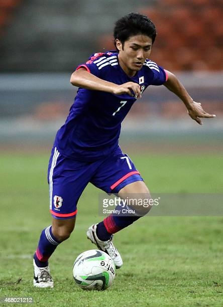 Ryota Oshima of Japan runs with the ball during the AFC U23 Championship qualifier Group I match between Vietnam and Japan at Shah Alam Stadium on...