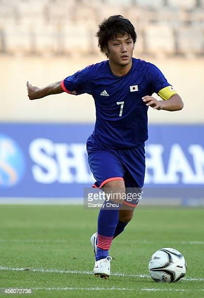 Ryota Oshima of Japan runs with the ball during the Football Mens Round of 16 match between Palestine and Japan during day five of the 2014 Asian...