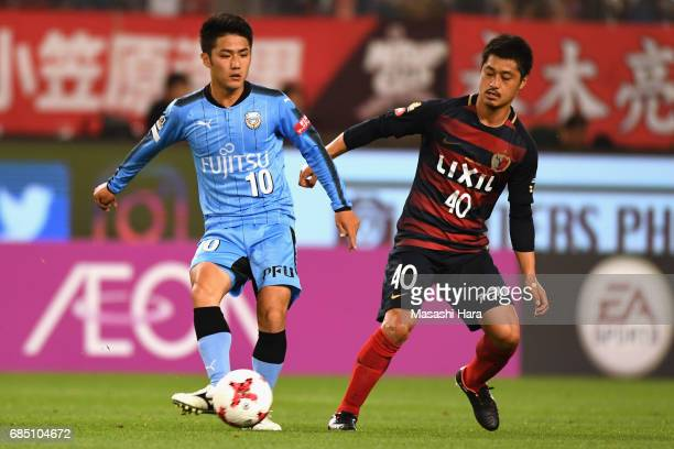 Ryota Oshima of Kawasaki Frontale and Mitsuo Ogasawara of Kashima Antlers compete for the ball during the JLeague J1 match between Kashima Antlers...
