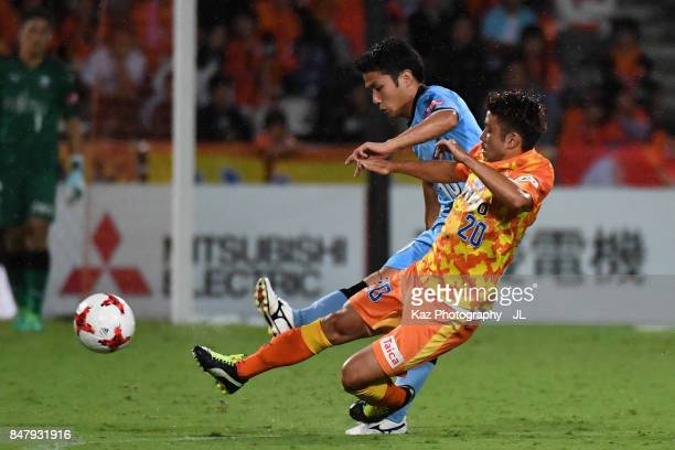Ryota Oshima of Kawasaki Frontale and Ryo Takeuchi of Shimizu SPulse compete for the ball during the JLeague J1 match between Shimizu SPulse and...